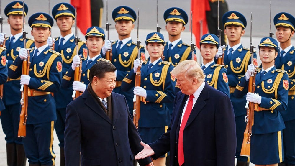 "From left, China's President Xi Jinping and U.S. President Donald Trump shake hands on Nov. 9, 2017, during a meeting outside the Great Hall of the People in Beijing. China and the United States have been engaged in a trade war that Trump says the U.S. is now ""winning."""