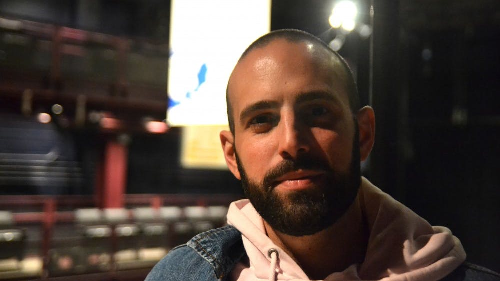 """Aaron Ricciardi stands Feb. 11 in the Wells-Metz Theatre in the Neal-Marshall Education Center. Ricciardi's play, """"Only Child,"""" will premiere at 7:30 p.m. Feb. 22 at the Wells-Metz Theatre."""