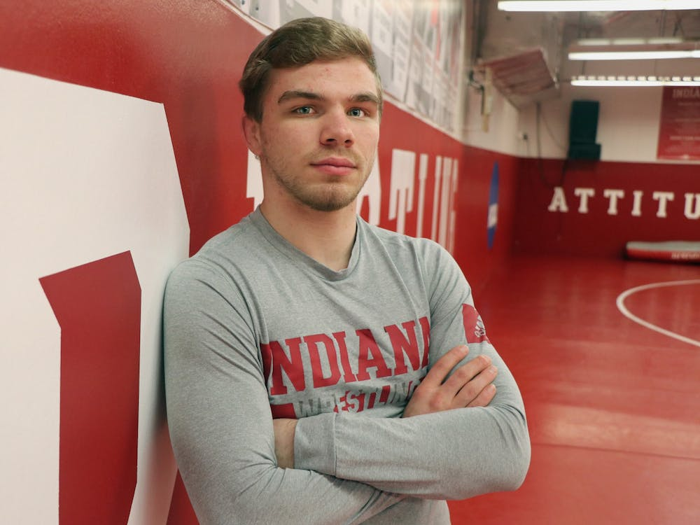 Then-junior Brock Hudkins stands for a headshot in the wrestling practice room in Simon Skjodt Assembly Hall. Hudkins was ranked No. 6 in the 125-pound class by Open Mat last week.