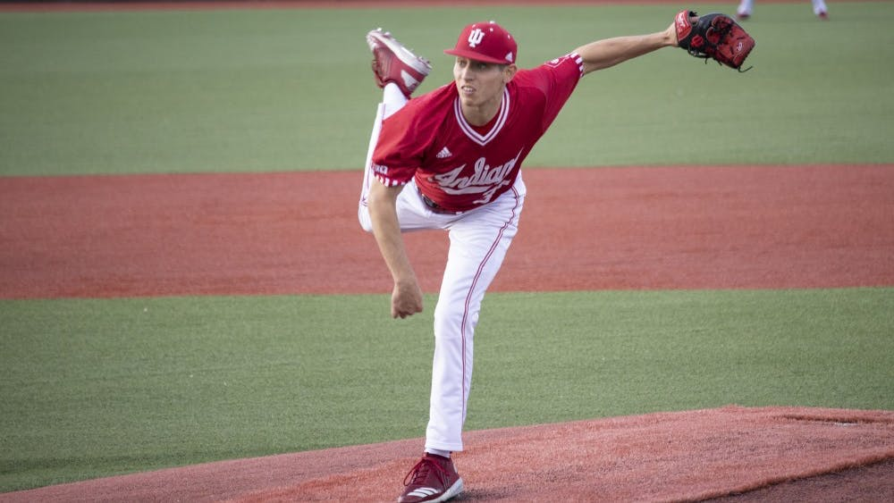 Freshman right-handed pitcher Gabe Bierman pitches the ball May 14 at Bart Kaufman Field. IU played the University of Louisville and lost, 8-7.