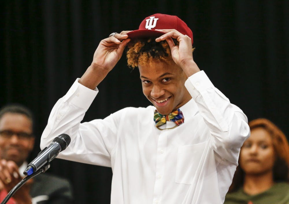 <p>New Albany High School senior Romeo Langford puts on an IU hat to officially announce his commitment to the IU men's basketball team during Langford's announcement Monday night at New Albany High School in New Albany, Indiana.</p>