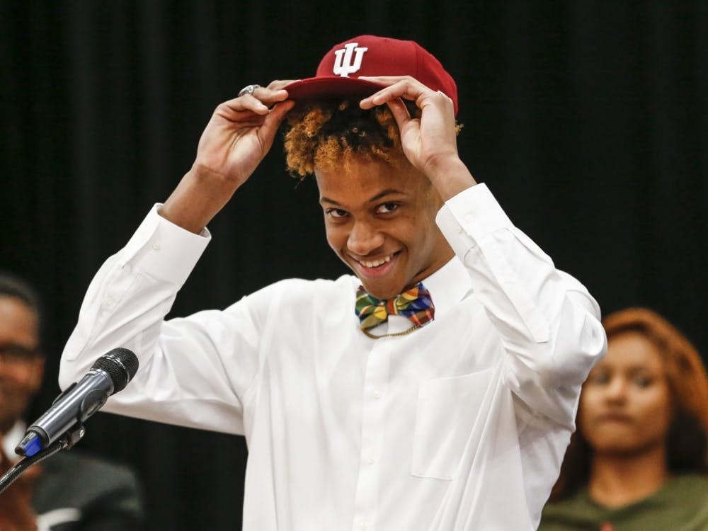 New Albany High School senior Romeo Langford puts on an IU hat to officially announce his commitment to the IU men's basketball team during Langford's announcement Monday night at New Albany High School in New Albany, Indiana.