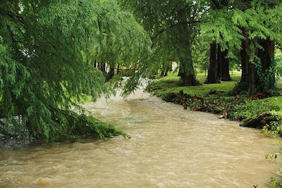 The Jordan River overflowed and flooded small sections of campus after a downpour Thursday morning.