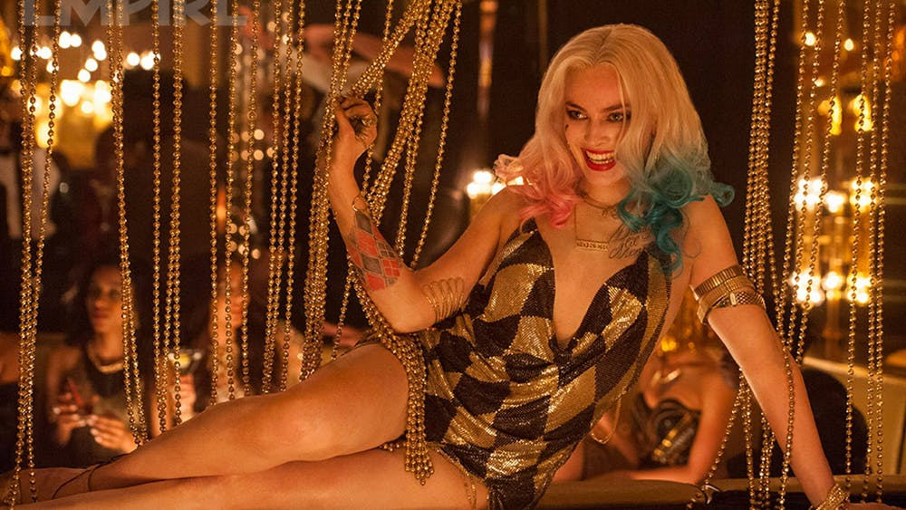 """Actress Margot Robbie sits down in the movie """"Suicide Squad."""""""