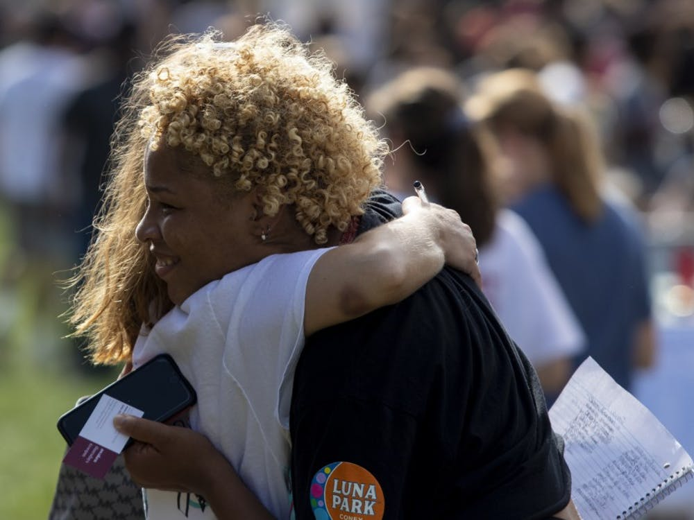 Sophomore Xakilah Daniel hugs senior Ellie Johnson during the Student Involvement Fair on Aug. 29 in Dunn Meadow. Daniel and Johnson are members of Shatter the Silence, which advocates for ending sexual violence.