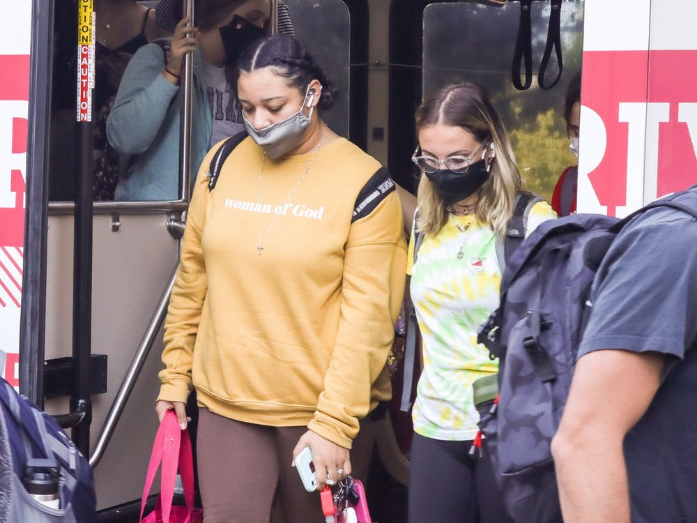 Students exit the W bus on Sept. 8, 2021, outside of the IU Auditorium. All passengers are required to wear masks on IU public transportation, according to the IU Campus Bus Service website.