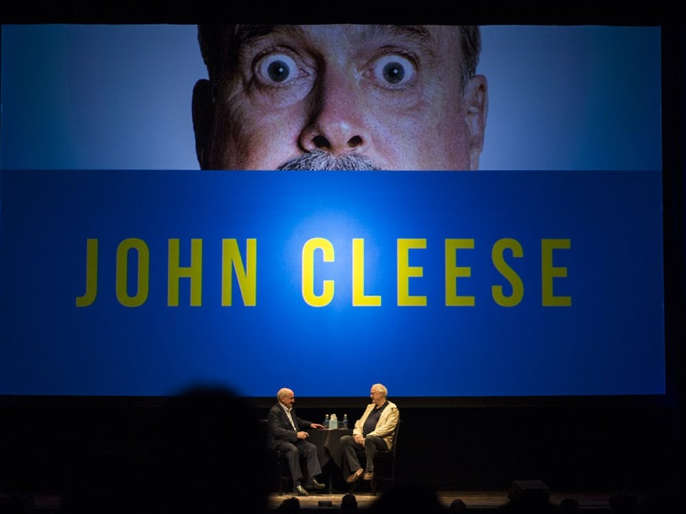 IU President Michael McRobbie greets John Cleese on Sunday afternoon at the IU Auditorium. John Cleese was a member of Monty Python, one of the most prolific comedy groups in history.