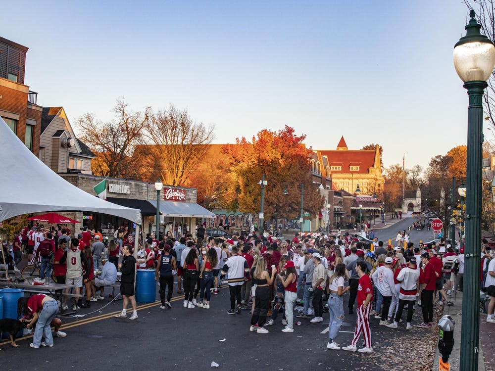 IU students join together in celebration Nov. 7, 2020, on Kirkwood Avenue in Bloomington. The Centers for Disease Control and Prevention observed rapid case growth among student populations in the two weeks following a university campus opening.