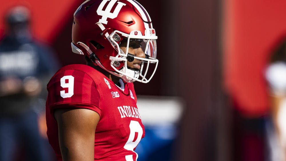 Redshirt sophomore quarterback Michael Penix Jr. looks at the field Oct. 24, 2020 in Memorial Stadium. Collegiate athletes at IU have started to receive sponsorships, and columnist Bradley Hohulin discusses brands certain athletes should partner with.