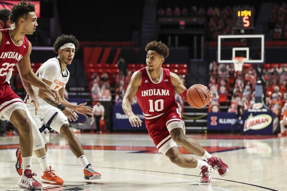 <p>Then-junior guard Rob Phinisee dribbles the ball Dec. 26, 2020, at the State Farm Center in Champaign, Illinois. Indiana men&#x27;s basketball players will be compensated for poster sales at Hoosier Hysteria on Saturday.</p>