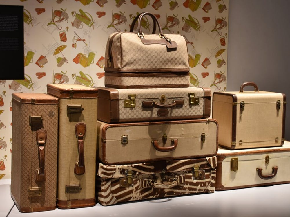 Suitcases designed by Gucci during the 20th century are highlighted in one section of the Gucci Museo in Florence.
