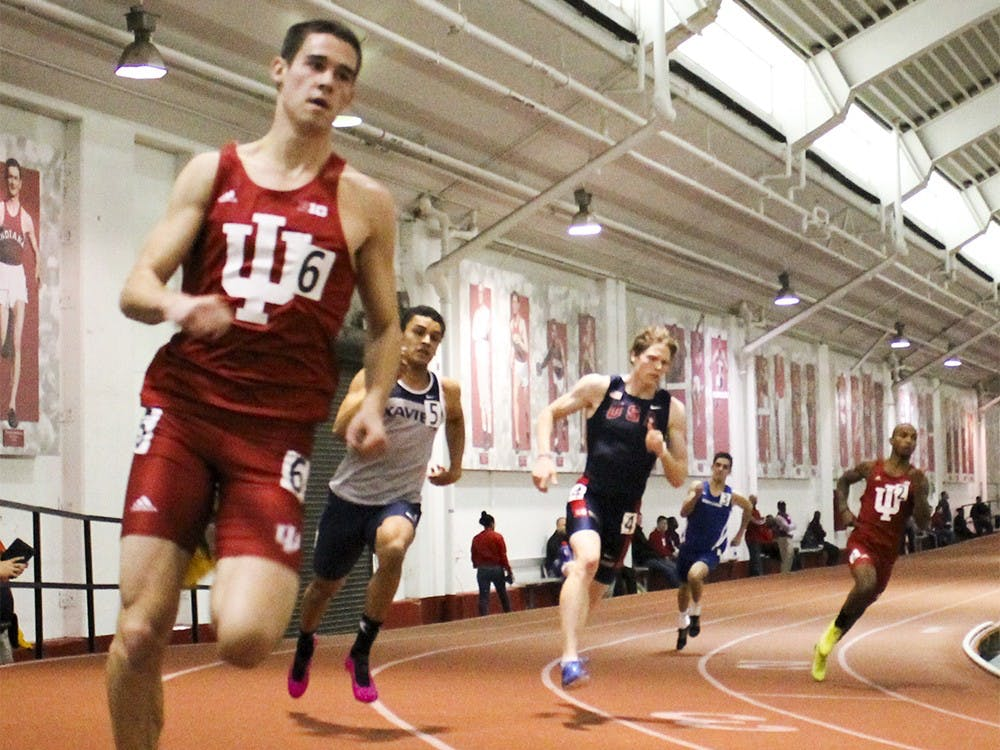 Then-Sopheremore Marco Burkert,left, and Then-Junior Reggie Smith, right, run in the 400 meter dash during the Indiana University Relays meet Jan. 31, 2015.