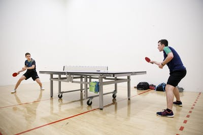 Freshman Sharon Alguetti, right, practices table tennis Aug. 8 with his brother, Gal, at the Student Recreational Sports Center. The brothers are trying to qualify for the 2020 Tokyo Olympics this year. CORRECTION: A previous version of this caption misidentified the brothers. The IDS regrets this error.