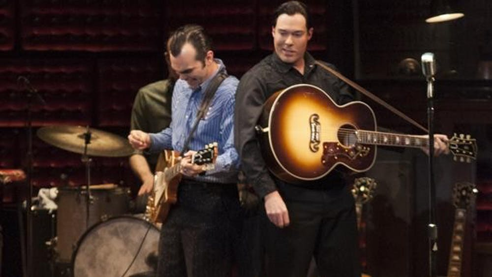 """Carl Perkins, played by James Barry, and Johnny Cash, played by Scott Moreau, finish performing """"Folsom Prison Blues"""" during the """"Million Dollar Quartet"""" on Tuesday at the IU Auditorium."""