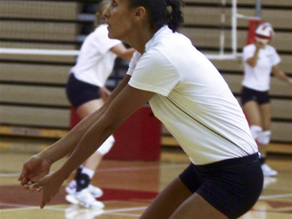 Linday Enterline prepares to return the ball during an Aug. 25, 2010 volleyball practice at University Gym.