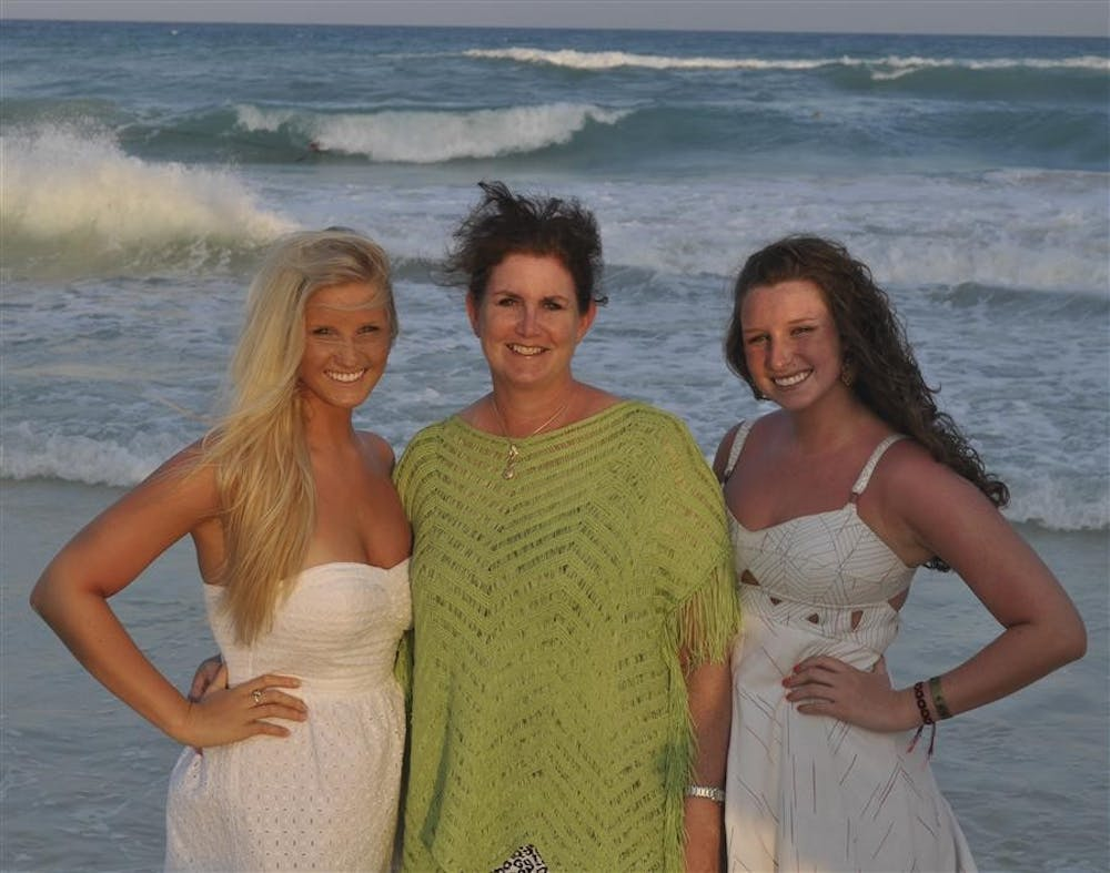 Freshman Abbey Bott, left, poses with her mother, Deborah Bott, and twin sister, freshman Olivia Bott, during a 2013 spring break trip to Playa del Carmen, Mexico. Abbey Bott, who died Sunday, hoped to major in exercise science and personal fitness.