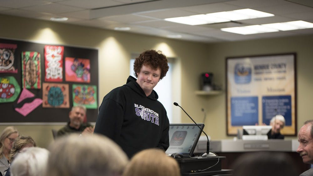 """Justin Robertson-Goodman received the Panther it Forward Award Tuesday night at the MCCSC school board meeting. Robertson-Goodman won the award for holding the doors open every day for teachers and students at Bloomington High School South. """"It fills me with joy in the morning,"""" he said."""
