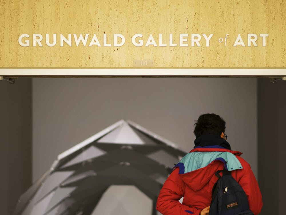 Then-junior Nicolas Martinez enters the Grunwald Gallery of Art, a gallery on the second floor of the Fine Arts Building that features art by professionals and students. The gallery is closed until further notice due to the coronavirus pandemic, but it will be presenting a new exhibition on its website.