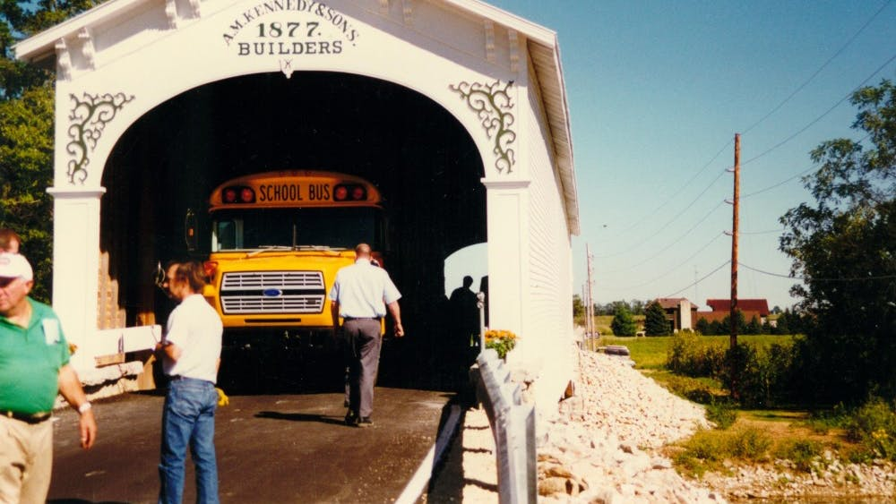 A school bus drives through the Smith Covered Bridge in Rush County, Indiana, after its reopening in 1996. The reconstructed covered bridge coming to Monroe County will look much like the Smith Covered Bridge when finished.