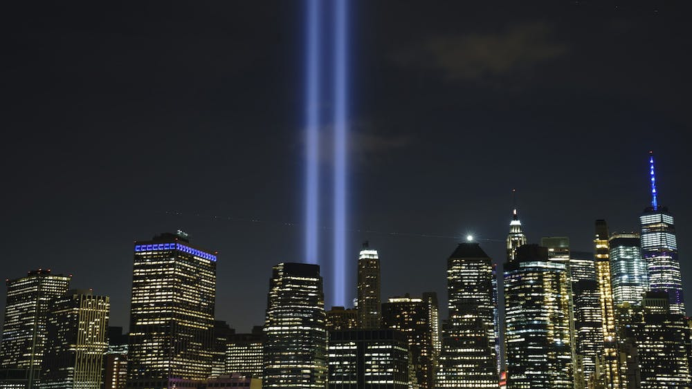 """The """"Tribute in Light"""" rises skyward on the 18th anniversary of the 9/11 terrorist attacks on Sept. 11, 2019, in New York City. During an event open to the public, seven surviving members of the 9/11 Commission will meet on Oct. 12 at the IU Auditorium to discuss their work, recommendations and effect on the status of U.S. National Security."""
