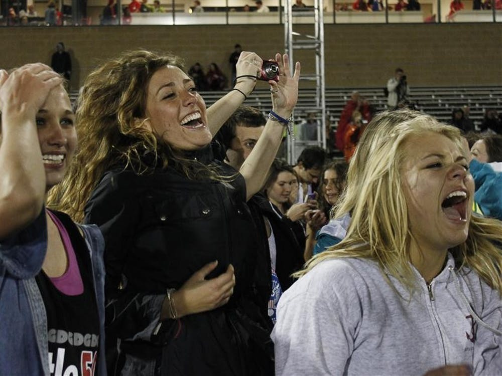 Delta Gamma supporters cheer as the sorority's team receives the first place trophy at the 2012 women's Little 500 on Friday at Bill Armstrong Stadium.
