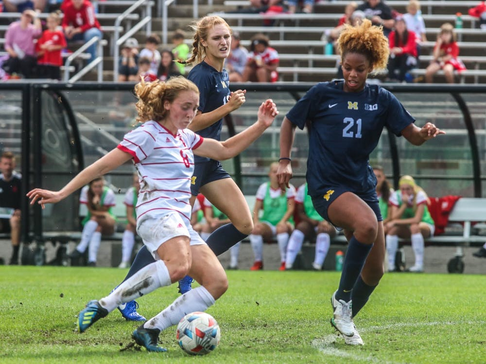Junior midfielder Avery Lockwood goes to kick the ball Oct. 3, 2021, in Bill Armstrong Stadium against Michigan. Indiana and Michigan drew 0-0 after the game was called due to bad weather.