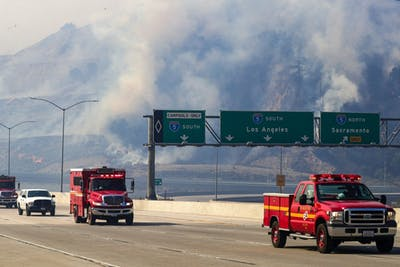 Freeway 5 and 14 are closed to traffic through Newhall Pass on Oct. 11 because of Saddle Ridge fire in Newhall, California.