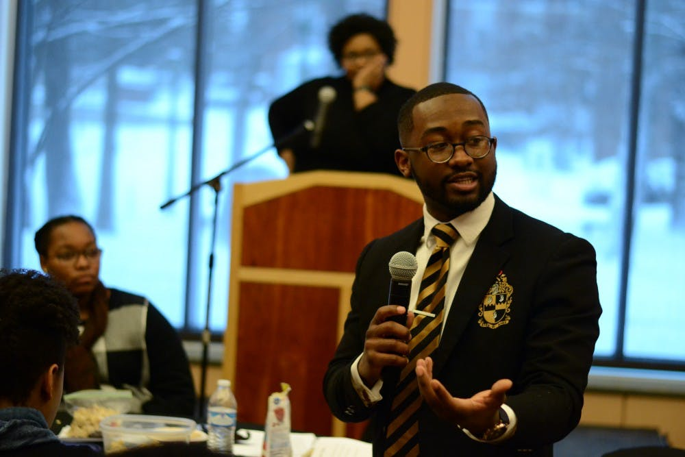 <p>Senior Calvin Sanders discusses diversity at the Martin Luther King Jr. Day Unity Summit. The summit was put on Monday at the Neal-Marshall Black Culture Center.</p>