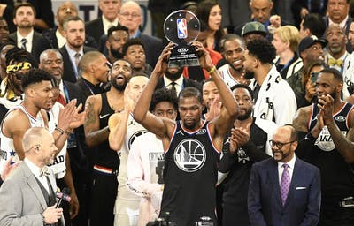 Kevin Durant of the Golden State Warriors raises the MVP trophy after the 2019 NBA All-Star game Feb. 17 at Spectrum Center in Charlotte, North Carolina.