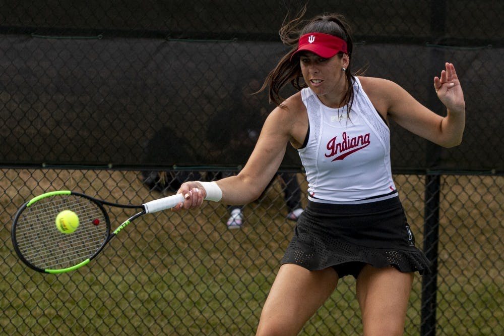 <p>Graduate student Annabelle Andrinopoulous strikes the ball Sept. 29 at the IU tennis courts. Andrinopoulos spent her first four seasons at the University of Colorado before transferring to IU. </p>