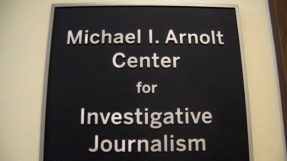 The sign for the Arnolt Center for Investigative Journalism hangs a wall Sept. 5 in Franklin Hall.