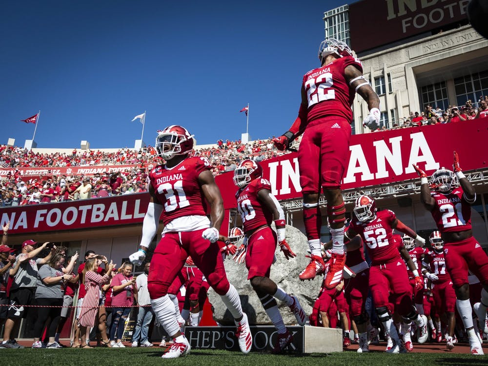 IU football players take the field at the start of a game at Memorial Stadium. The NCAA released new COVID-19 protocols for the fall 2021 season Wednesday.