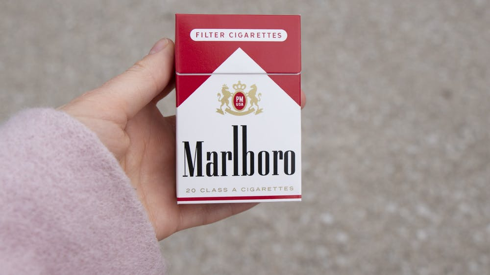 A person holds a pack of Marlboro cigarettes Feb. 3 near Monroe County Public Library. A new law was signed by President Donald Trump Dec. 20, 2019, that has made the legal age for purchasing tobacco products 21.