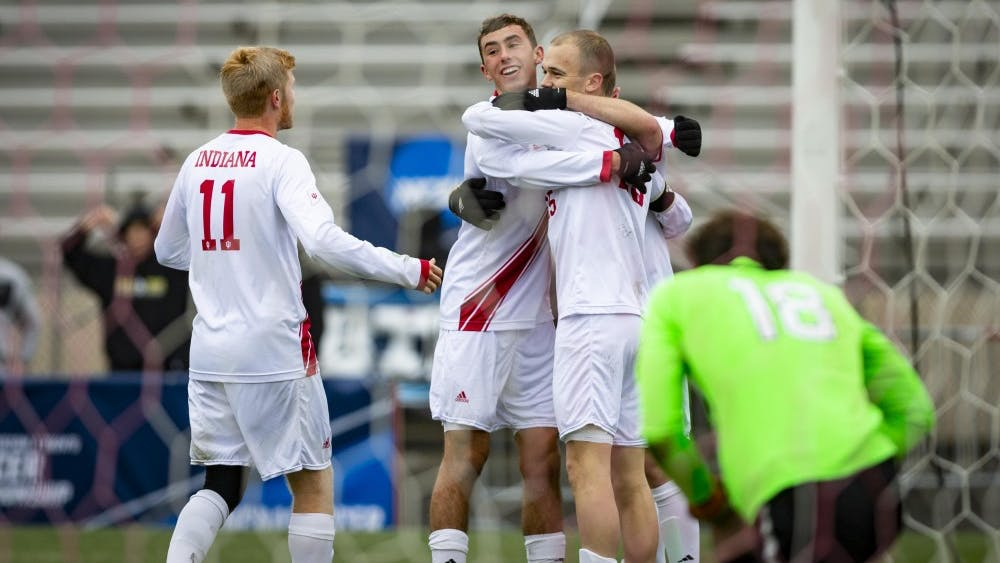 Members of the IU men's soccer team celebrate after senior defender Timmy Mehl scores a third goal during IU's game against the University of Connecticut on Nov. 18 at Bill Armstrong Stadium. IU defeated UCONN 4-0 in the second round of the NCAA Tournament to advance to round 16.