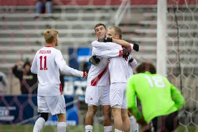 Members of the IU men's soccer team celebrate after senior defender Timmy Mehl scores a third goal during IU's game against the University of Connecticut on Nov. 18 at Bill Armstrong Stadium. IU defeated UCONN 4-0 in the second round of the NCAA Tournament to advance to the round of 16.
