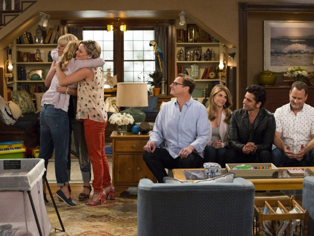 """John Stamos, Andrea Barber, Candace Cameron Bure, Dave Coulier, Lori Loughlin, Bob Saget and Jodie Sweeton in """"Fuller House."""" (Netflix)"""