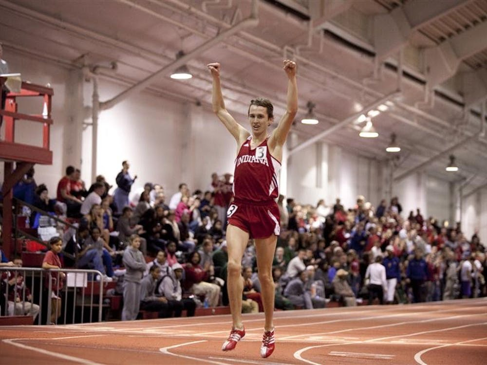 Then-sophomore Andy Bayer celebrates setting IU's 3000 meter record in 7:48.35 during the Gladstein Invitational on Jan. 21, 2011 held indoors at the Gladstein Field House.