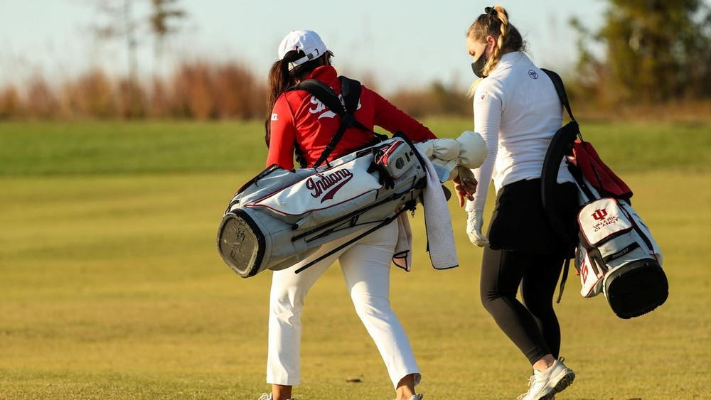 Members of the IU women's golf team talk Sunday after the first day of the Palmetto Intercollegiate tournament. IU women's golf opened the season Sunday at the Palmetto Intercollegiate.