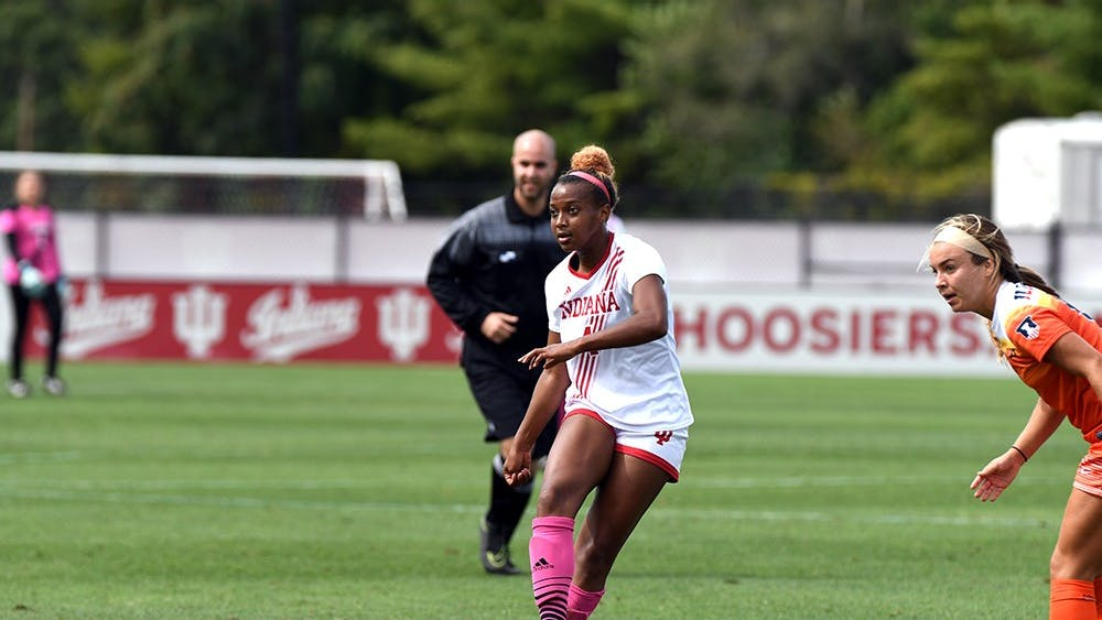 Redshirt junior forward Mykayla Brown passes the ball against Illinois on Oct. 1 at Bill Armstrong Stadium. IU will not make the postseason after reaching the Big Ten Tournament last season.