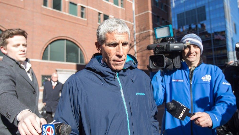 """William """"Rick"""" Singer leaves Boston Federal Court after being charged with racketeering conspiracy, money laundering conspiracy, conspiracy to defraud the United States and obstruction of justice March 12 in Boston. Singer is among several charged in an alleged college admissions scam."""