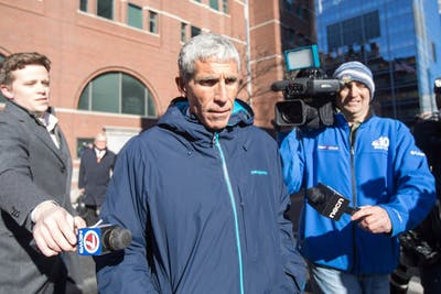 "William ""Rick"" Singer leaves Boston Federal Court after being charged with racketeering conspiracy, money laundering conspiracy, conspiracy to defraud the United States and obstruction of justice March 12 in Boston. Singer is among several charged in an alleged college admissions scam."