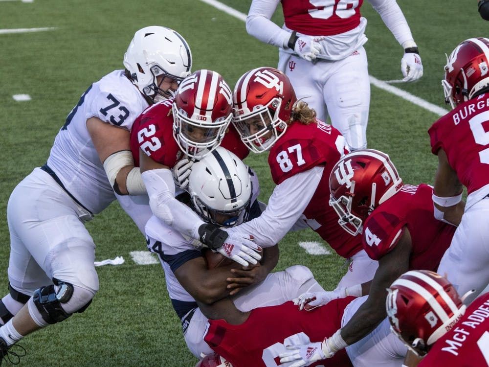 Then-senior defensive lineman Michael Ziemba and then-junior defensive back Jamar Johnson tackle Penn State then-freshman running back Keyvone Lee on Oct. 24, 2020, in Memorial Stadium. Indiana will face off against Penn State on Saturday in State College, Pennslyvania.