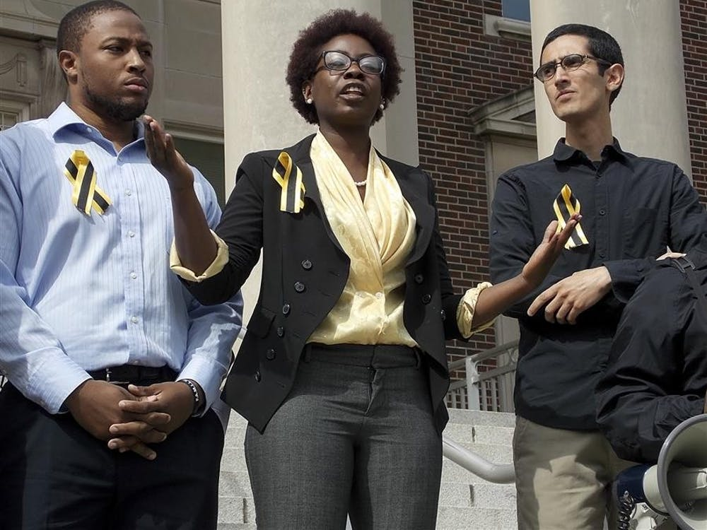 Purdue junior Ebony Barnett-Kennedy speaks to the crowd of students, faculty and staff about the need for more diversity Friday on the steps of Hovde Hall at Purdue University.