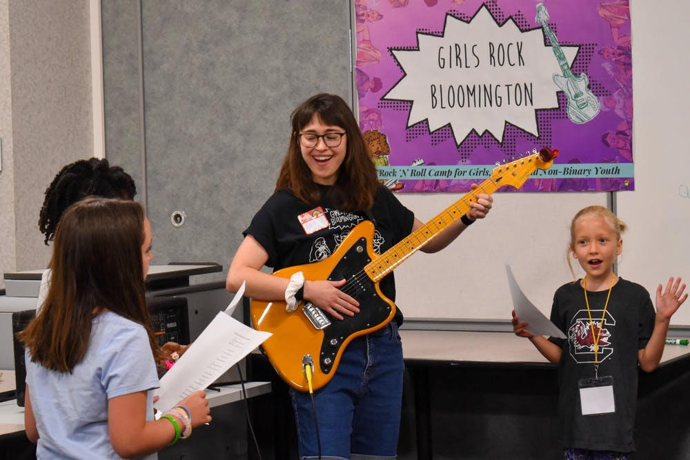 <p>Girls Rock founder and camp director Amy Oelsner plays guitar at the Girls Rock summer camp in 2019. Girls Rock started a community fund Jan. 15 to lower the cost of their summer camp for participants. </p>