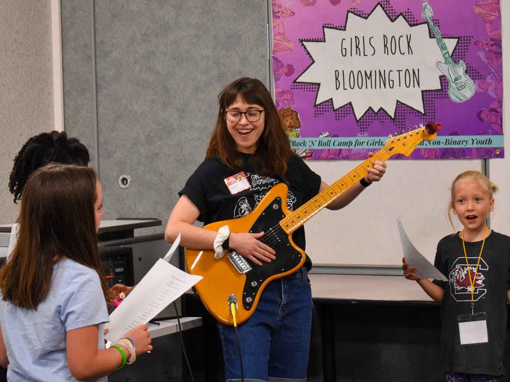 Girls Rock founder and camp director Amy Oelsner plays guitar at the Girls Rock summer camp in 2019. Girls Rock started a community fund Jan. 15 to lower the cost of their summer camp for participants.