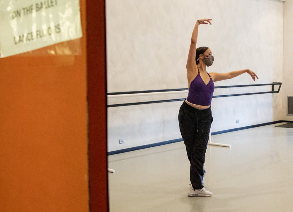 <p>Senior Alex Jones practices Sept. 23 in the Musical Arts Center. The ballet department has adjusted to  COVID-19 guidelines by reducing studio capacity, reducing group sizes and enforcing social distancing. </p>