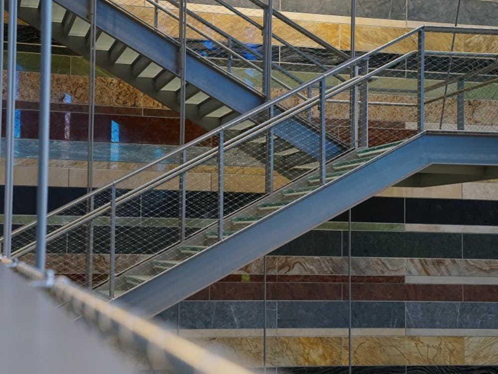 Located in the atrium behind the three-story staircase in the Global and International Studies Building is a stone wall. The Stones of the World on the wall face east and include stones from 10 different countries and six continents.