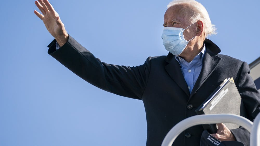 Then-Democratic presidential nominee Joe Biden boards his campaign plane at New Castle Airport on Nov. 2 in New Castle, Delaware. Biden defeated incumbent Donald Trump to become the 46th president of the United States.
