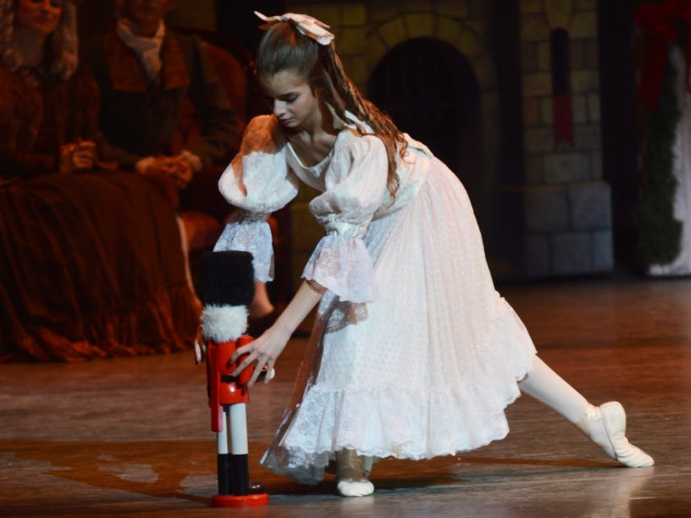 """Aika Noguchi bends to pick up a nutcracker during a 2015 dress rehearsal of """"The Nutcracker"""" in the Musical Arts Center. The traditional ballet tells the story of a young girl and her godfather that go to magical lands where toys come alive."""