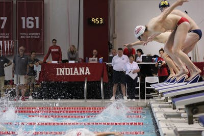 Swimmers in the men's 400 free relay kick off their starting blocks Nov. 2 at the Counsilman-Billingsley Aquatics Center. The IU men's swimming team will compete in Knoxville, Tennessee, this weekend, while the diving team will compete in Indianapolis.